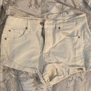 White shorts with tribal print on the sides